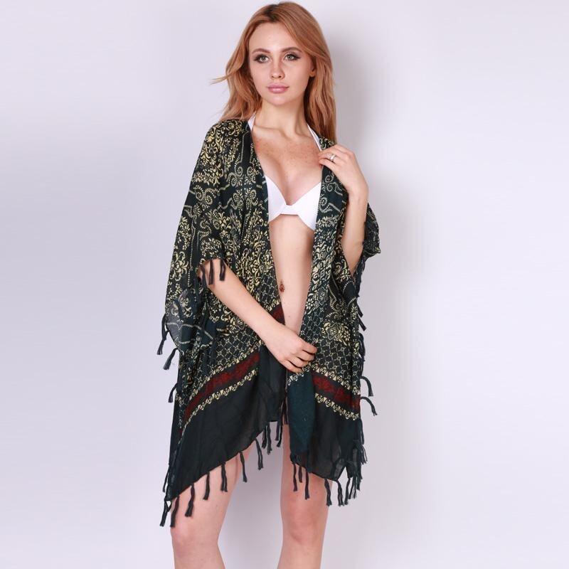 ได้แก่ เฉียวแฟชั่นสตรีเสื้อชายเสื้อห้อยพู่พิมพ์ Kimono บีชเสื้อสเวตเตอร์ถักหลายสี (ในประเทศ)