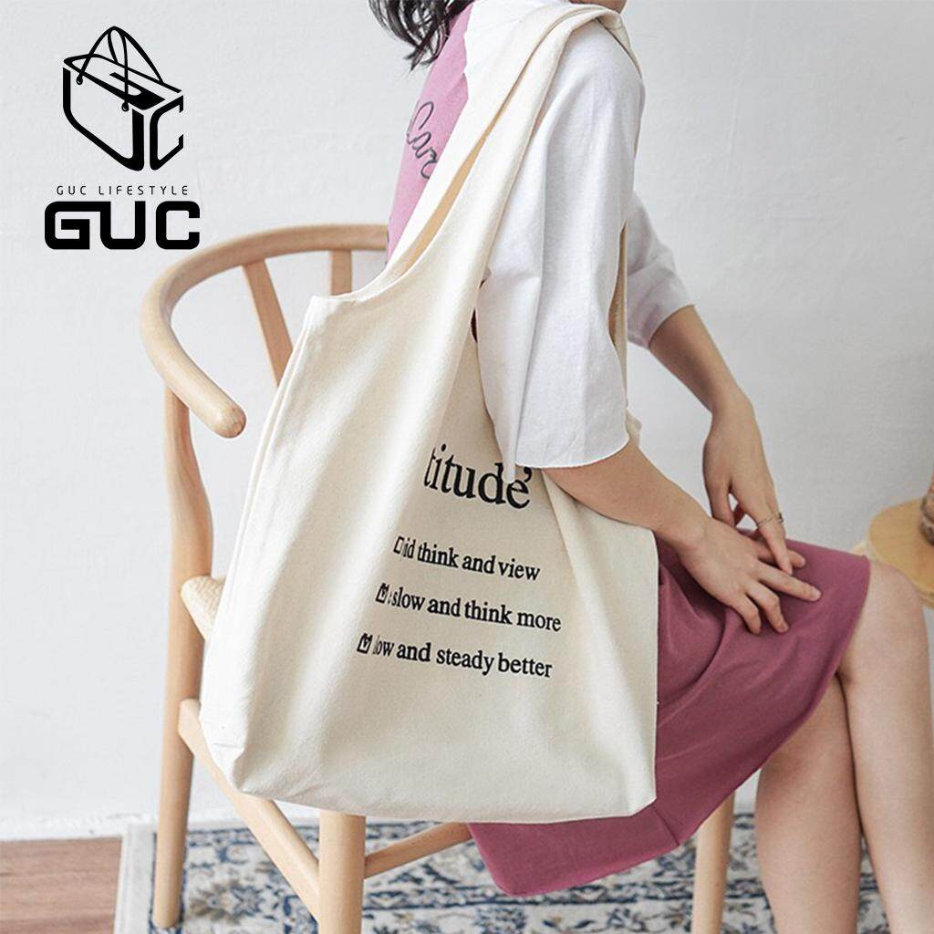 กระเป๋าถือ นักเรียน ผู้หญิง วัยรุ่น หนองคาย GUC new✨กระเป๋าผ้าattitude ใบใหญ่สุดคุ้ม GUC B631