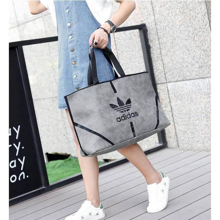 กระเป๋าเป้สะพายหลัง นักเรียน ผู้หญิง วัยรุ่น สมุทรสงคราม กระเป๋าสะพายทรง Tote Adidas Originals Shopper Tote Bag Y2018