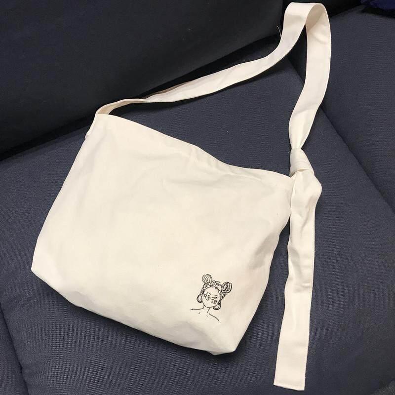กระเป๋าสะพายพาดลำตัว นักเรียน ผู้หญิง วัยรุ่น ระนอง INS เสื้อผ้าแฟชั่น ลมขี้เกียจหญิงสะพายข้างกระเป๋าผ้าใบความจุขนาดใหญ่สไตล์เกาหลีสไตล์ญี่ปุ่นนักเรียนไหล่ข้างเดี่ยวกระเป๋าผ้าแบบเย็บสายชุดชั้นในสามารถปรับได้