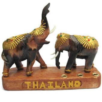 ช้างไม้สักคู่ เสียบปากกา วางบนโต๊ะทำงาน