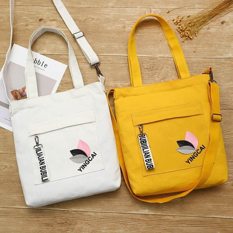 กระเป๋าเป้ นักเรียน ผู้หญิง วัยรุ่น สกลนคร กระเป๋าผ้าสะพายข้างใบใม้สามสีงานดีสดใสน่ารัก B1038
